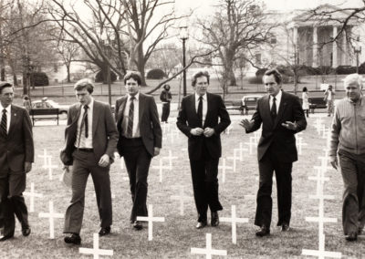 Congressmen and senators planted 250 crosses, one for each farm failing every day across the country in March 1985.  From left:  Rep. Berkley Bedell (IA), Rep. Tim Penney (MN), Rep. Lane Evans (IL), Sen. Gary Hart (CO), Sen. Tom Harkin (IA), Sen. John Melcher (MT)