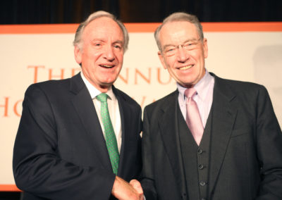 Sen. Tom Harkin poses with Sen. Chuck Grassley at the Hoover Wallace Dinner.