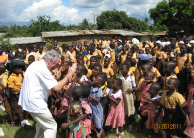 Sen. Tom Harkin greets children on a trip to West Africa.