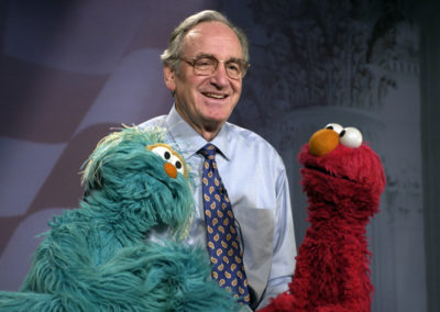 Sen. Tom Harkin poses with Sesame Street characters Elmo and Rosita while they recorded a Healthy Minute about healthy food and exercise for the Iowa Communications Network in 2005.