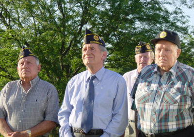 Tom Harkin stands with veterans at a ceremony.