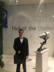 2018 D.C. Experience Scholarship Recipient Wyatt Anderson in front of a piece of artwork at the Hall of States.
